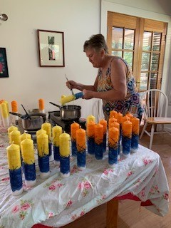 Lynne adding the final touches to the last 10 of the candles for Synod 2021!